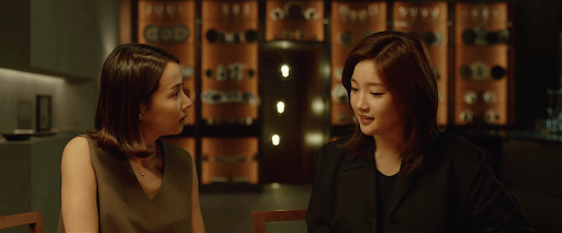 The mother of the Park family (Yeo-jeong Jo) (left) being manipulated by the daughter of the Kim family (So-dam Park) (right).